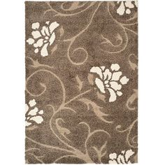 Treat your feet to the soft material of this patterned gray shag rug. This handwoven rug features a fun floral design and looks lovely near front doors or below kitchen sinks. Durable and attractive, this rug adds style to nearly any room.
