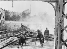 Belgian Army engineers destroying a road and railway bridge in Termonde to hold up the German advance before retreating to Antwerp on 18 September 1914.