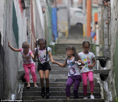 The gangs selling young girls' virginities on the streets of Colombia http://www.dailymail.co.uk/news/...  In Medellin, the home town of notorious drug lord Pablo Escobar, the tradition of offering girls up for orgies with mafia kingpins is now depressingly common (file picture).