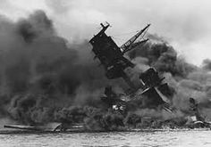 This is a picture from World war 2 of the bombing of Pearl Harbour. This is a primary source because it was taken as the Japanese let their bombs go on Pearl Harbour.  The incident of Pearl Harbour was when the Japanese had released bombs on to a US base that was being used as support for the allied of the US in World War 2. This was the spark that officially got the US into World War 2.