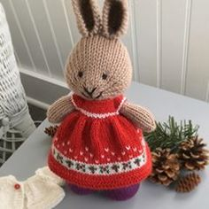 Red Holiday Dress🎄🎄🎄 Chart and project details on Ravelry.user name: suzymarie Red Holiday Dress, Holiday Dresses, Animal Tattoos For Men, Little Cotton Rabbits, Rabbit Toys, Knit Picks, Baby Cartoon, Christmas Knitting, Preschool Crafts