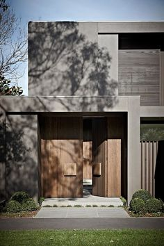 Heavy wooden doors bring a unique element to the modern extreior