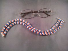 """Rainbow Loom EYEGLASS LANYARD. Designed and loomed by Tina Fraser. Tina said: """"Clear bands are what attach to the eyeglass arms.""""  (Rainbow Loom FB page) 02/25/14"""