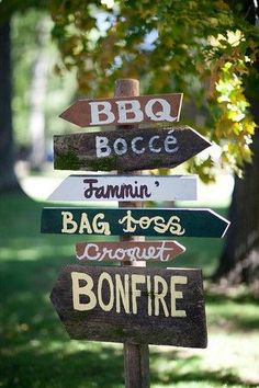 Wood painted direction sign post with stand for in the garden. Bar/Cocktails Croquet Bocce Bean bag toss