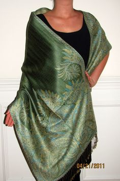 Pashmina shawls are perfect for fall and look great with most outfits. Buy a solid green pashmina or a silk paisley pashmina on sale today.