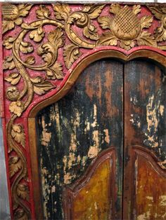 Detail picture of an Antique Balinese Temple Door from the Impact Imports collection.  Hand crafted from teak, this piece is a work of art!