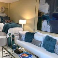 This beautiful dorm room includes an elegant coffee table and a pullout sofa from IKEA. - Courtesy of After Five Designs Dorm Couch, Dorm Room Bedding, College Dorm Bedding, College Dorm Rooms, College Life, Dorm Life, Disney College, Girl Bedding, Queen Bedding