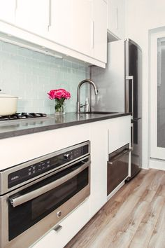 Name: Jennifer Pade Type of Project: Kitchen remodel Location: West Village, New York, New York Type of building: 300 square foot apartment in a co-op building For those of you who have been following along with Jennifer's NYC kitchen remodel, and who saw the truly dire state of her original kitchen, this reveal will be especially satisfying. The work is done, the dust has cleared, and now it's time to take a look at the finished product.