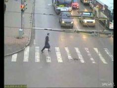 CCTV captures man narrowly avoiding being hit by a car and a bus