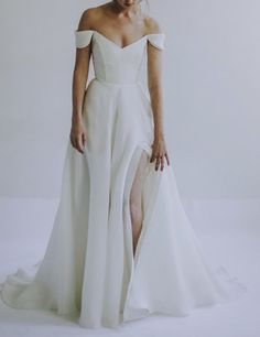 Dec 2019 - Leanne Marshall's 'Eliza' is a minimalist gown in silk gazaar with wide V-neckline and petaled off-shoulder sleeve. Supportive boned bodice with V-back. Clean A line skirt with side slit and train. Wedding Dress Low Back, Off Shoulder Wedding Dress, Dream Wedding Dresses, Wedding Gowns, Cowl Wedding Dress, Wedding Dresses With Color, A Line Wedding Dress With Sleeves, Bodice Wedding Dress, Wedding Ceremonies