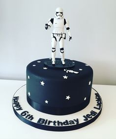 Star Wars cake with a storm trooper topper.