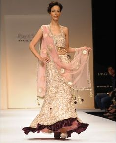 Blush lehenga in raw silk, zardozi embroidery and encrusted crystals all over, halter blouse.  Payal Singhal $2500