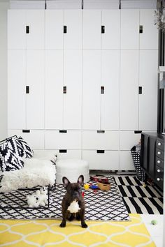 good looking minimalistic storage solution for cheap - wall of Ikea stuva