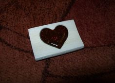 Self-made wooden pendant with resin heart. It is made of oak wood and resin of spruces from forest.
