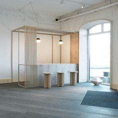 Danish design studio Oeo has used the wooden planks produced by Dinesen to create furniture and structures for the brand's flagship showroom in Copenhagen.