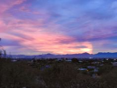 """Photographs of Southen Arizona Sunrises and Sunsets: Tucson Sunsets. Hi, I'm Jim Collopy. I own Fort Lowell Realty & Property Management in Tucson/Phoenix. My photography """"project"""" the past two years was to take a sunset photo from my back yard in the Catallina Foothills every night I was in town. As you can see I saw a different """"painting"""" almost every night. Enjoy."""