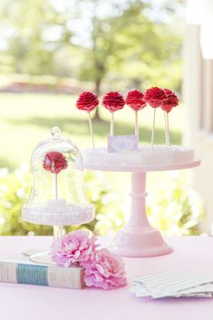 Rose cake pops at a Cinderella birthday party! See more party planning ideas at CatchMyParty.com!