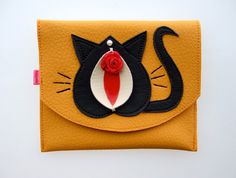 The Pussy Galore Vulvette in mango. Vagina purse, pussy purse, vulva purse made from vegan leather.