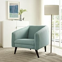 Maintain continuity with Slide. Designed to personify progressiveness, Slide comes in polyester with a finely stitched trim for elegant appeal. Outfitted with dark walnut stained dowel wood legs, plush dense foam padding, and a rich mid-century style, the Slide armchair imparts a rewarding seating experience for contemporary living rooms, lounge spaces, and reception areas.