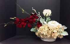 Holiday 2014 Season faux floral: Pearl cream glitter hydrangeas, powder winter white roses and red magnolia branch on silver jeweled puck vase. Original design and arrangement by http://nfmdesign.synthasite.com/