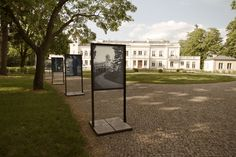 Outdoor exhibition system - Studio Robot,  An outdoor exhibition system for the European Art Center in Sanniki, Poland. The racks were designed to aesthetically correspond with architectural details of the Sanniki Palace. The construction of the frames prevents posters from adverse weather conditions and enables the user to change them easily. The system allows changing the arrangement of the boards in the park comfortably. It is also easy to disassemble and store in the wintertime.
