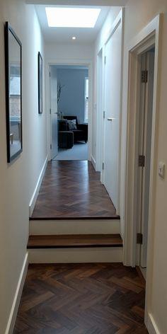 WALNUT PARQUET IN HALLWAY This dark walnut parquet wooden floor was fitted in this hall with a matching engineered walnut step.