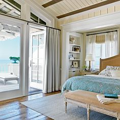 Inside of this Seaside, Florida, master suite, vaulted ceilings provide a breezy touch and pine floors evoke an earthy feel. | Coastalliving.com