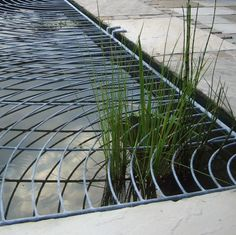 contemporary ripple design metal pond cover | James Price Blacksmith Designer |