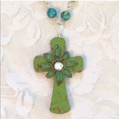 "NEW SILVER TURQUOISE & GREEN CROSS NECKLACE NEW HANDCRAFTED BEAUTIFUL SILVER, TURQUOISE, & GREEN CROSS NECKLACE.  CROSS PENDENT IS A RUSIC WOOD WITH RHINESTONE ACCENT.                                           LENGTH:  28""   PENDANT: 2.5"" ADORNED BY AMIE Jewelry Necklaces"