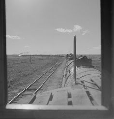 Atchison, Topeka and Santa Fe freight train rounds a curve at Yeso, New Mexico.  Seen from the cupola of the caboose.