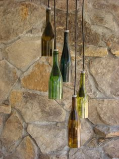 Check out our wine bottle lights selection for the very best in unique or custom, handmade pieces from our ornaments & accents shops. Beer Bottle Crafts, Wine Bottle Art, Lighted Wine Bottles, Bottle Lights, Wine Bottle Chandelier, Diy Artwork, Wine And Beer, Hanging Lights, Home Deco
