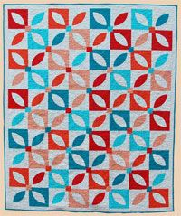 Dance with Me by Abbey Lane Quilts at KayeWood.com uses fashionable solids put into a traditional orange peel block.  The end result is this beautiful quilt. http://www.kayewood.com/item/Dance_With_Me_Quilt_Patern/2894 $9.50