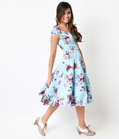 Pin-up perfection on pointe! A sumptuous circle printed stunner in sky blue and a rich floral, the Royal Ballet dress is a perfectly patterned frock in a marvelous midcentury cut. With a fairytale-like sweetheart and cap sleeved bodice that's formed to fi
