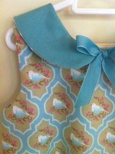 Girls Bluebird Dress, $42, Royal Little Darling, via Etsy.