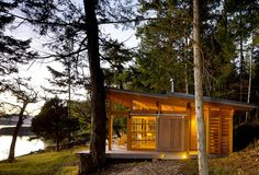 One of four remote, distinctly designed, and spectacular little cabins on the Gulf Islands of British Columbia, designed by famed architect Osburne Clarke. Built with sustainability in mind, each of these four off-grid cabins has a layout fitted into the same square footage footprint. | Tiny Homes