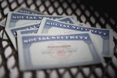 Close-up of social security cards - Glowimages/Getty Images