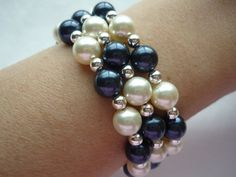 Triple strand Swarovski pearl bracelet with sterling silver beads.  Pearls are cream and night blue (midnight blue).