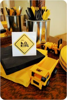 "You could to the black and yellow like this with trucks as centerpieces and not have to spend so much on ""themed"" plates, napkins, etc."