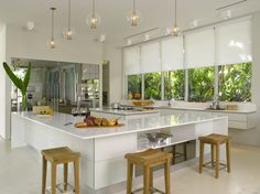 A brilliant white kitchen design with Silhouette® window shadings in the Elle Décor Modern Life Concept House showhouse in Sunset Isles, Miami Beach, Florida ♦ Hunter Douglas window treatments available at Ed Selden Carpet One. Large Window Treatments, Farmhouse Window Treatments, Kitchen Window Treatments, Modern Windows, Large Windows, Hunter Douglas, Modern Farmhouse Kitchens, Home Kitchens, Decor Blinds