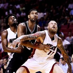 All eyes were on the prize as the Heat carved out a 97-94 preseason win over the Spurs in Miami last night despite Tim Duncan's best efforts - the Spurs forward (#21) went 7-for-7 from the floor scoring 14 points in just 19 minutes. Rookie Justise Winslow (#20) made his third appearance while the Heat's Chris Anderson (#11) put up three assists.  Photo by Greg Nelson for Sports Illustrated #nba #timduncan @birdzilla.ro @iamjustise by sportsillustrated