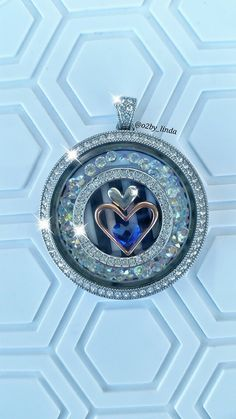 Legacy locket from Origami Owl. This one is big and blingy! Swarovski crystals…