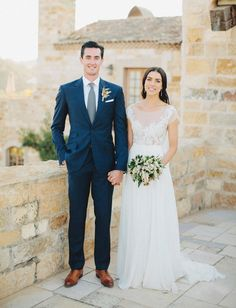 Simply gorgeous bride and dapper groom. Lapel Pin and awesome shoes act as beautiful highlights to a simple suit.