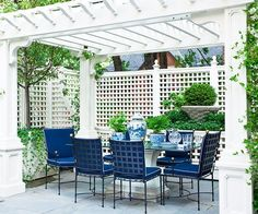 Chinoiserie Chic: Blue and White Chinese Planters -  <3 the grid latticework on the chair backs and the trellis