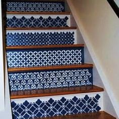 I want to do this to my stairs so bad!  Maybe not this pattern . . .
