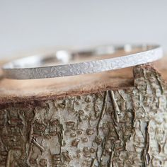 Looking for a special #personalised #gift for her? Here's a pretty solid silver #bangle with floral print. Choose this  personalised bracelet as a gorgeous gift for girlfriend... #etsyjewelry #floral #bracelet #girlfriend #wife