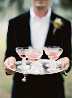 Pretty pink cocktails on a silver platter