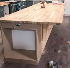 How we created our DIY Kitchen Island with prefab cabinets, a little trim, and unfinished butcher block countertops for an upscale custom look. Outdoor Kitchen Countertops, Diy Kitchen Island, Kitchen Ideas, Soapstone Kitchen, Kitchen Cabinets, Kitchen Counters, How To Remove Kitchen Island, Kitchen Decor, Ikea Island Countertop