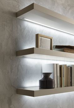 Matt beige argilla lacquered, 50mm thick, I-modulART shelves with led lighting above and below.__ Mensole Sp.50 I-modulART laccato opaco beige argilla con illuminazione a led inferiore e superiore.