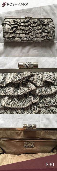Bebe Ruffle Trim Snake Print Clutch Bebe snake print ruffle trim wallet clutch in black and white. Used a few times and still in great condition! Snap closure with classic logo print interior. bebe Bags Clutches & Wristlets