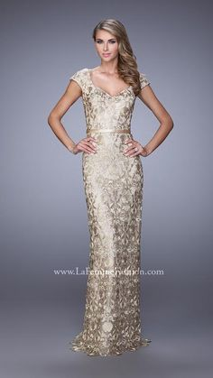 Stunning metallic lace gown with capped sleeves. There is a satin belt around waistline. Dress has a low V back and a center slit.    Gold/Nude Dress Style 21680   La Femme